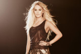 Sobrecargada Carrie Underwood opta por la pompa so...